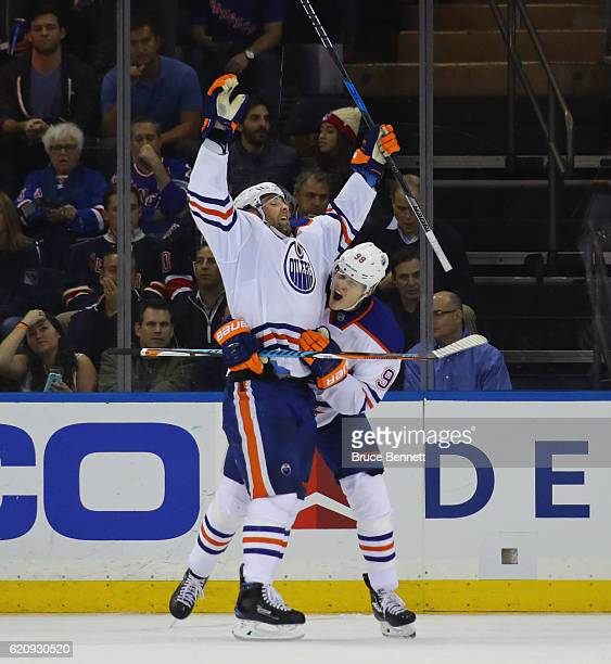 Patrick Maroon of the Edmonton Oilers scores at 1028 of the second period against the New York Rangers and is grabbed by Jesse Puljujarvi at Madison...