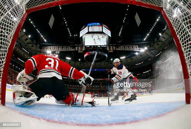 Patrick Maroon of the Edmonton Oilers scores on goalie Anton Forsberg of the Chicago Blackhawks in the first period at the United Center on October...
