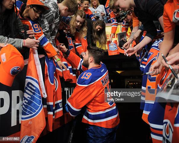 Patrick Maroon of the Edmonton Oilers signs autographs prior to the game against the Vancouver Canucks on April 6 2016 at Rexall Place in Edmonton...