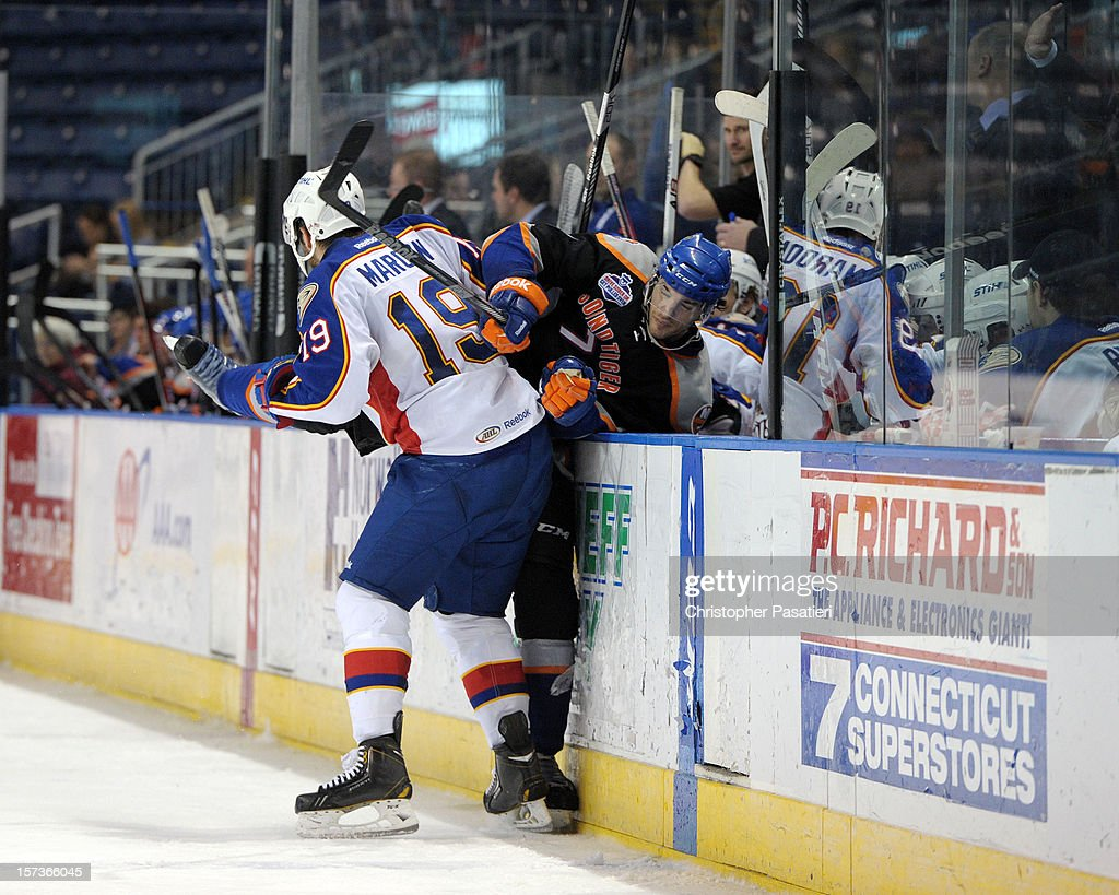 Patrick Maroon #19 of the Norfolk Admirals checks Jon Landry #7 of the Bridgeport Sound Tigers in to the bench during an American Hockey League game on December 2, 2012 at the Webster Bank Arena in Bridgeport, Connecticut. The Admirals defeated the Sound Tigers 4-1.