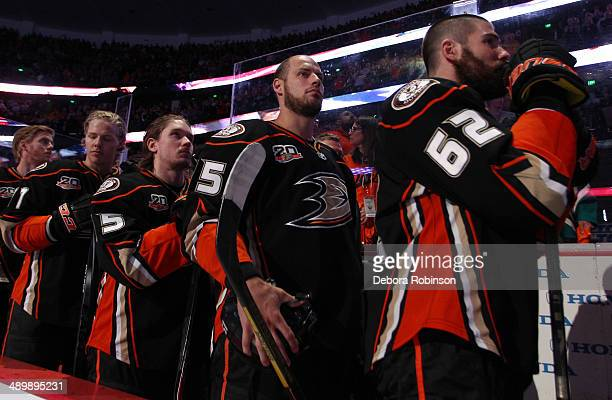 Patrick Maroon Ryan Getzlaf Sami Vatanen and Hampus Lindholm of the Anaheim Ducks stand during the national anthem before the game against the Los...