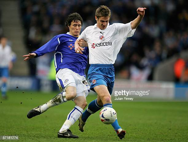 Patrick McCarthy of Leicester battles with Kevin Doyle of Reading during the CocaCola Championship match between Leicester City and Reading at the...