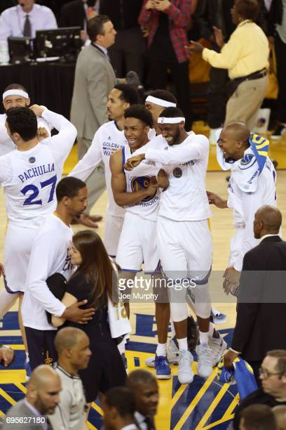 Patrick McCaw and Ian Clark of the Golden State Warriors celebrate after winning Game Five of the 2017 NBA Finals against the Cleveland Cavaliers on...