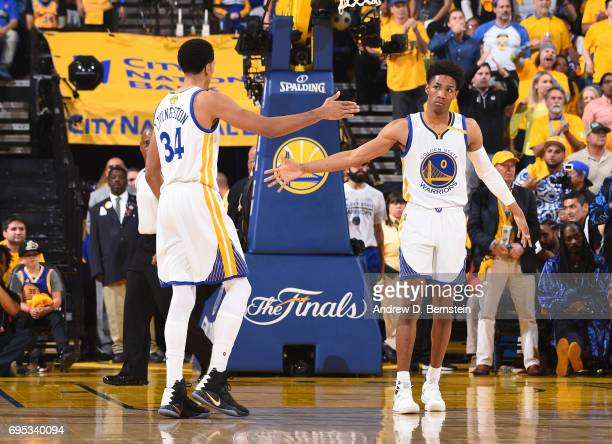 Patrick McCaw and Shaun Livingston of the Golden State Warriors highfive in Game Five of the 2017 NBA Finals on June 12 2017 at ORACLE Arena in...