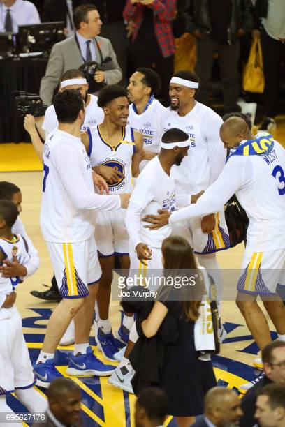 Patrick McCaw and the Golden State Warriors celebrate after winning Game Five of the 2017 NBA Finals against the Cleveland Cavaliers on June 12 2017...