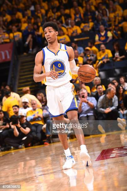 Patrick McCaw of the Golden State Warriors dribbles the ball up court against the Portland Trail Blazers during Game Two of the Western Conference...