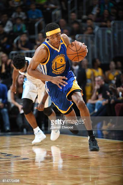 Patrick McCaw of the Golden State Warriors drives to the basket against the Denver Nuggets on October 14 2016 at Pepsi Center in Denver Colorado NOTE...