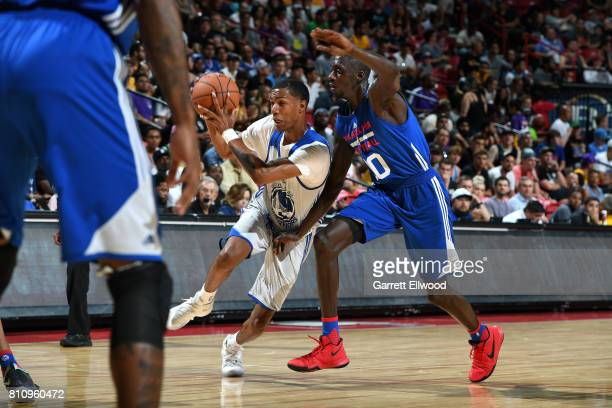 Patrick McCaw of the Golden State Warriors drives to the basket during the game against Brandon Austin of the Philadelphia 76ers during the 2017 Las...