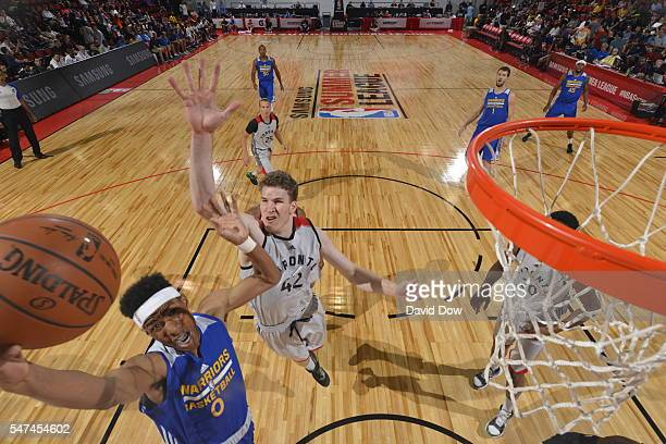 Patrick McCaw of the Golden State Warriors goes to the basket against Jakob Poeltl of the Toronto Raptors during the 2016 NBA Las Vegas Summer League...
