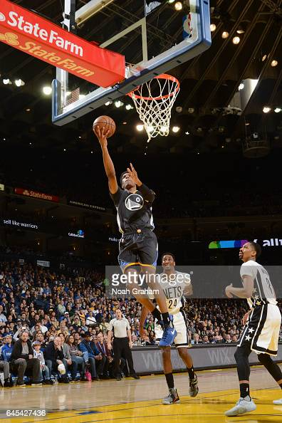 Patrick McCaw of the Golden State Warriors goes to the basket against the Brooklyn Nets on February 25 2017 at ORACLE Arena in Oakland California...