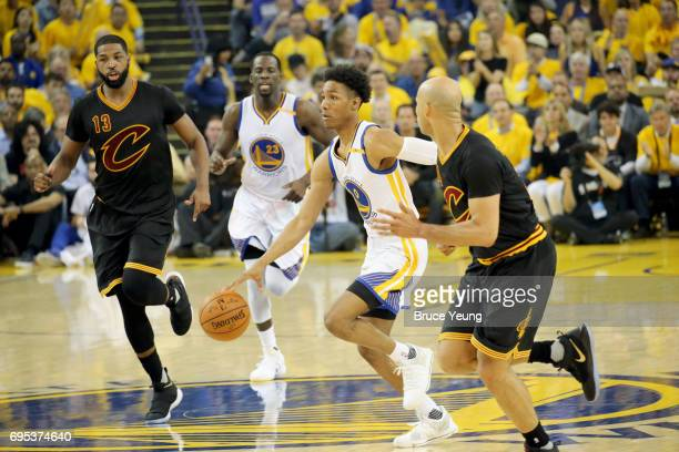 Patrick McCaw of the Golden State Warriors handles the ball against the Cleveland Cavaliers in Game Five of the 2017 NBA Finals on June 12 2017 at...