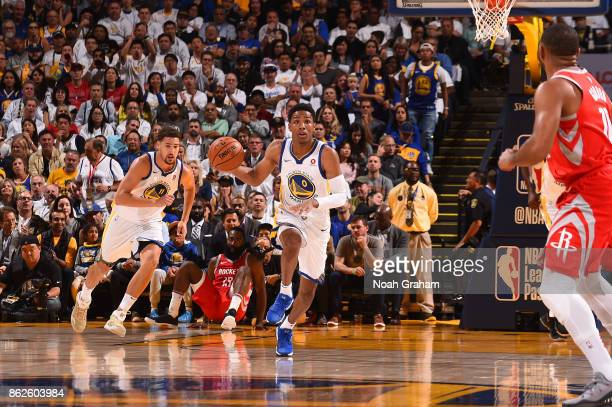 Patrick McCaw of the Golden State Warriors handles the ball against the Houston Rockets on October 17 2017 at ORACLE Arena in Oakland California NOTE...