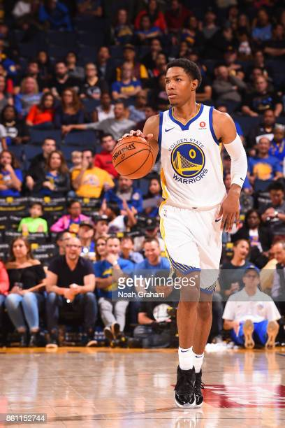 Patrick McCaw of the Golden State Warriors handles the ball during preseason game against the Sacramento Kings on October 13 2017 at ORACLE Arena in...