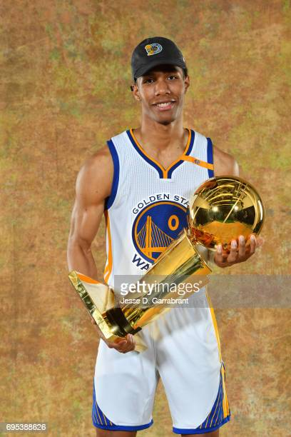 Patrick McCaw of the Golden State Warriors poses for a portrait with the Larry O'Brien Trophy after defeating the Cleveland Cavaliers in Game Five of...