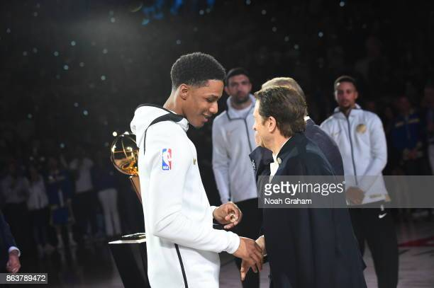 Patrick McCaw of the Golden State Warriors receives his rings during the NBA Championship ring ceremony before the game against the Houston Rockes on...