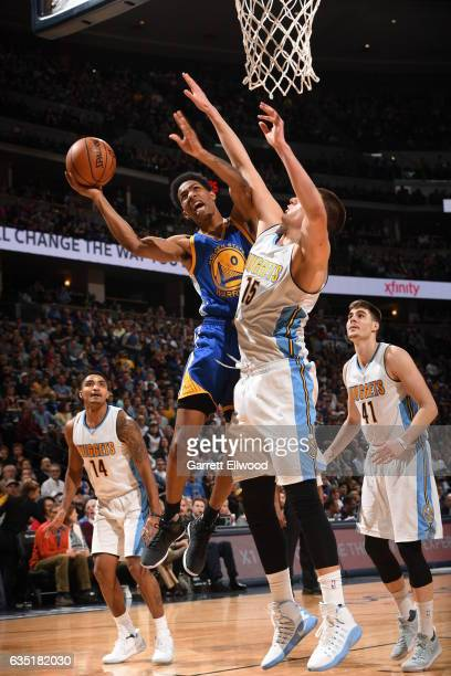 Patrick McCaw of the Golden State Warriors shoots the ball against the Denver Nuggets on February 13 2017 at the Pepsi Center in Denver Colorado NOTE...