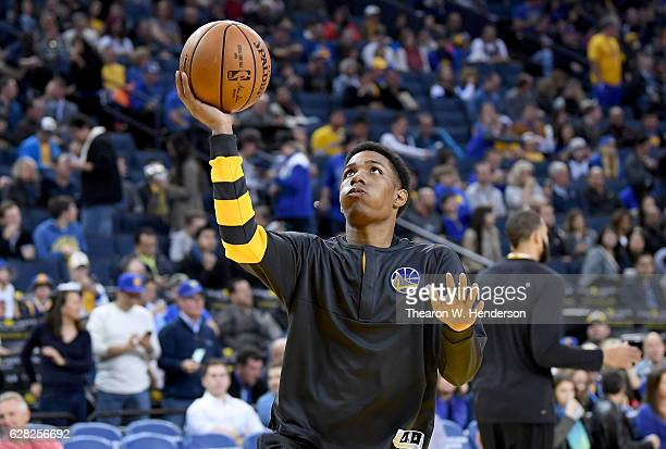 Patrick McCaw of the Golden State Warriors warms up prior to the start of an NBA basketball game against the Phoenix Suns at ORACLE Arena on December...