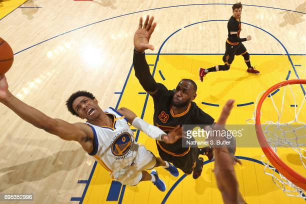 Patrick McCaw of the Golden State Warriors while LeBron James of the Cleveland Cavaliers goes for a block in Game Five of the 2017 NBA Finals on June...