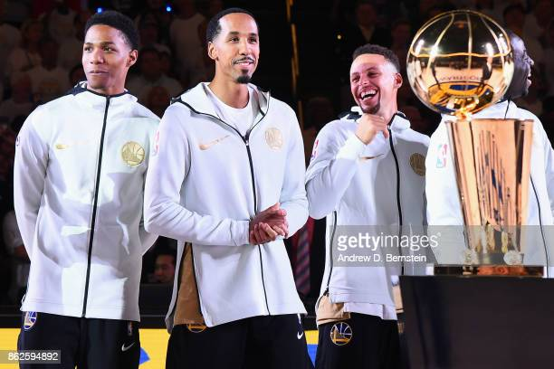 Patrick McCaw Shaun Livingston Stephen Curry and Draymond Green of the Golden State Warriors of the Golden State Warriors smile during the 2017 NBA...