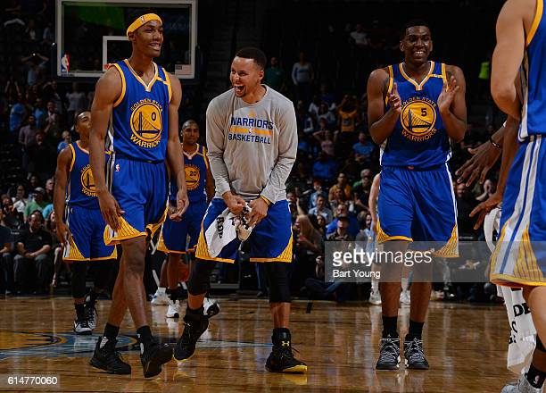 Patrick McCaw Stephen Curry and Kevon Looney of the Golden State Warriors celebrate during a preseason game against the Denver Nuggets on October 14...