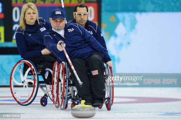 Patrick McDonald of the United States competes in the Wheelchair Curling Round Robin Session 11 during day six of Sochi 2014 Winter Paralympic Games...