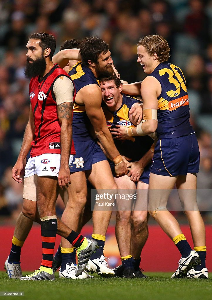 Patrick McGinnity of the Eagles celebrates a goal with Josh Kennedy and Jackson Nelson during the round 15 AFL match between the West Coast Eagles and the Essendon Bombers at Domain Stadium on June 30, 2016 in Perth, Australia.