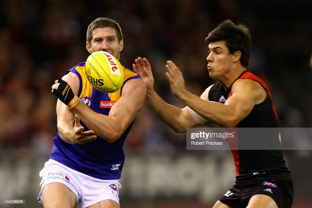 Patrick McGinnity of the Eagles handballs during the round seven AFL match between the Essendon Bombers and the West Coast Eagles at Etihad Stadium on May 12, 2012 in Melbourne, Australia.