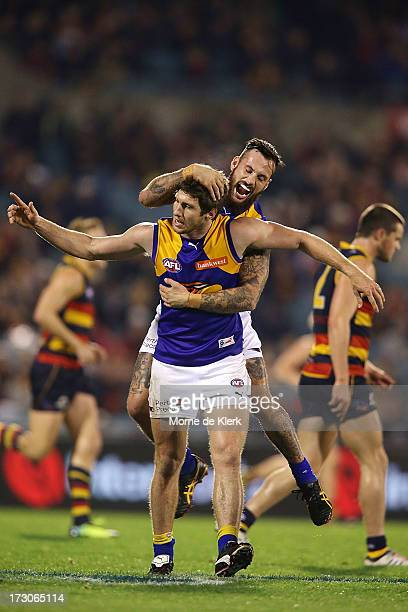 Patrick McGinnity of the Eagles is congratulated by teammate Chris Masten after he kicked a goal during the round 15 AFL match between the Adelaide...