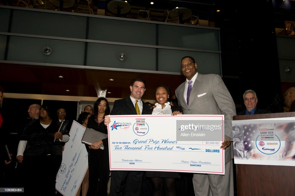 Patrick McInnis, Fathead CEO, and Rick Mahorn, Detroit Piston legend, pose with Shantell Williams after presenting the third place scholarship check during the Detroit Pistons, Quicken Loans, and Fathead Know Your Black History Event at the Compuware Building on February 23, 2011 in Detroit, Michigan.