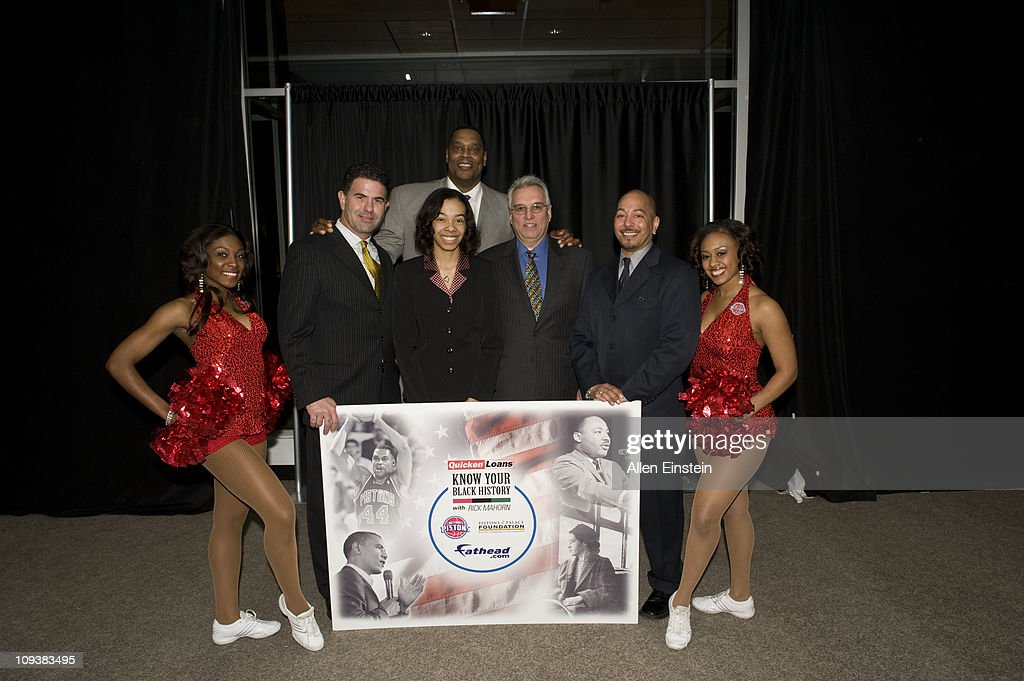Patrick McInnis, Fathead CEO, Rick Mahorn, Detroit Piston legend, Stephen Luigi Piazza, Quicken Loans Vice President , Brian Stevenson, Fathead Vice President, and Automotion member pose with Krystal Holmes after she received the first place scholarship check during the Detroit Pistons, Quicken Loans, and Fathead Know Your Black History Event at the Compuware Building on February 23, 2011 in Detroit, Michigan.