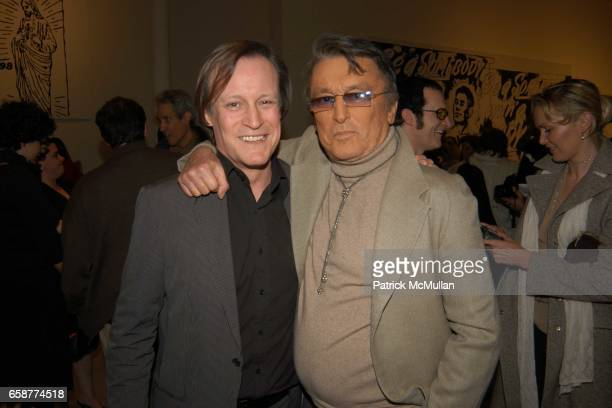 Patrick McMullan and Robert Evans attend Helmut Newton and Andy Warhol Exhibit at Gagosian Gallery New York Hotel on February 26 2004 in Beverly...
