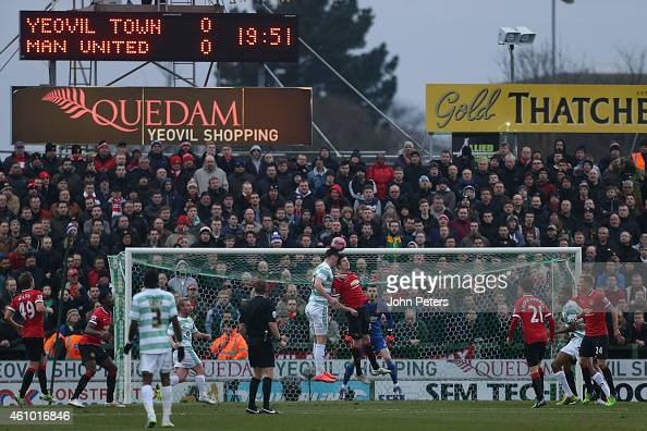 Patrick McNair of Manchester United in action with Kieffer Moore of Yeovil Town during the FA Cup Third Round match between Yeovil Town and...