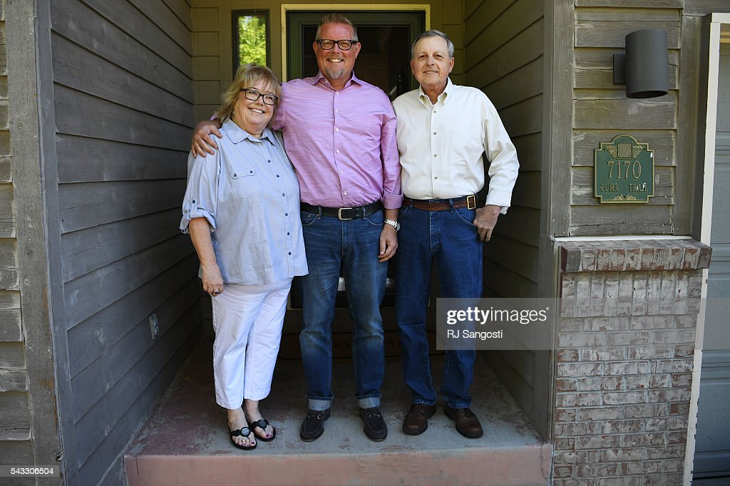 Patrick Meeker, center, stands with his birth parents, Mary and Barry Drotar outside their home in Littleton, June 24, 2016. Meeker used Ancestry.com's DNA test to track down a couple of second cousins and, eventually, connect with his birth parents, Mary and Barry Drotar.