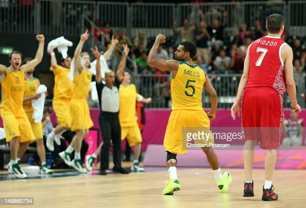 Patrick Mills of Australia celebrates after making the game winning three point shot against Russia in the final seconds of the Men's Basketball...