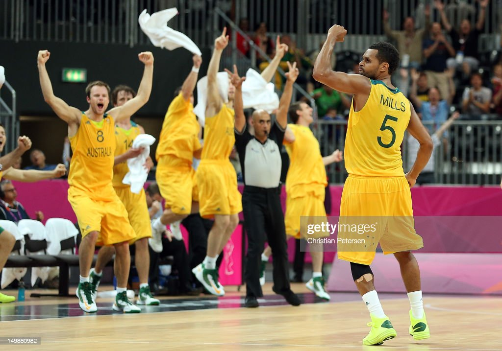<a gi-track='captionPersonalityLinkClicked' href=/galleries/search?phrase=Patrick+Mills&family=editorial&specificpeople=550011 ng-click='$event.stopPropagation()'>Patrick Mills</a> #5 of Australia celebrates after making the game winning three point shot against Russia in the final seconds of the Men's Basketball Preliminary Round match on Day 10 of the London 2012 Olympic Games at the Basketball Arena on August 6, 2012 in London, England.