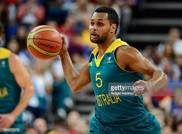 Patrick Mills of Australia passes the ball against the United States during the Men's Basketball quaterfinal game on Day 12 of the London 2012...