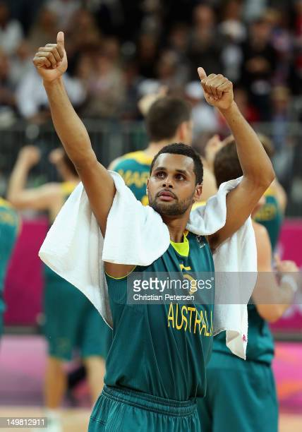 Patrick Mills of Australia reacts to the crowd after defeating Great Britain in the Men's Basketball Preliminary Round match on Day 8 of the London...