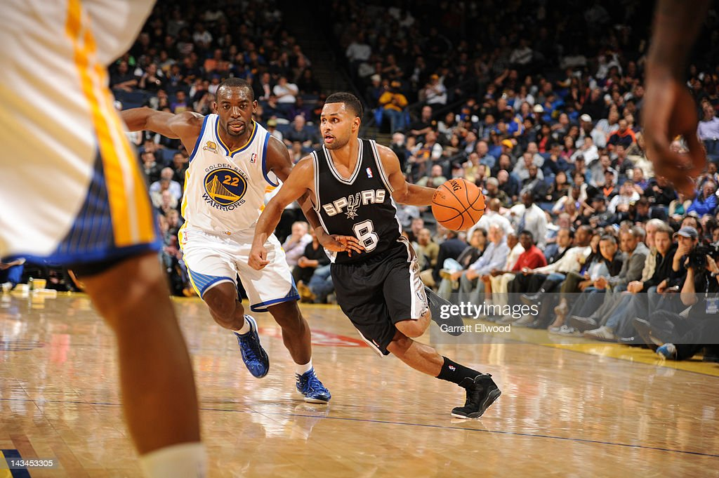 Patrick Mills #8 of the San Antonio Spurs drives against Charles Jenkins #22 of the Golden State Warriors on April 26, 2012 at Oracle Arena in Oakland, California.