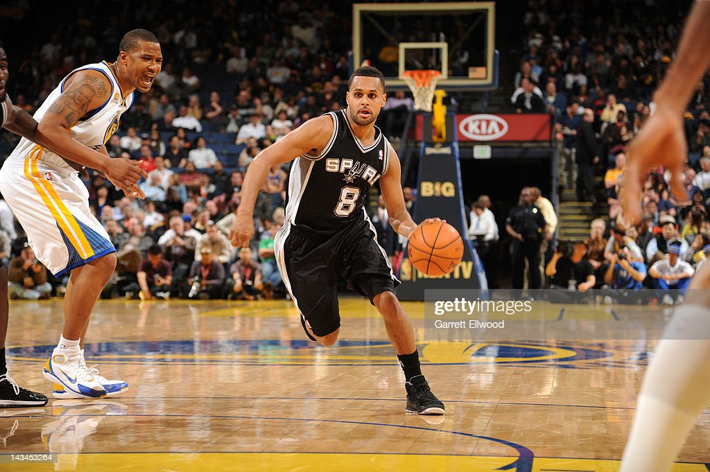 <a gi-track='captionPersonalityLinkClicked' href=/galleries/search?phrase=Patrick+Mills&family=editorial&specificpeople=550011 ng-click='$event.stopPropagation()'>Patrick Mills</a> #8 of the San Antonio Spurs drives against <a gi-track='captionPersonalityLinkClicked' href=/galleries/search?phrase=Dominic+McGuire&family=editorial&specificpeople=2537986 ng-click='$event.stopPropagation()'>Dominic McGuire</a> #5 of the Golden State Warriors on April 26, 2012 at Oracle Arena in Oakland, California.