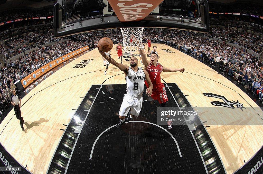 <a gi-track='captionPersonalityLinkClicked' href=/galleries/search?phrase=Patrick+Mills&family=editorial&specificpeople=550011 ng-click='$event.stopPropagation()'>Patrick Mills</a> #8 of the San Antonio Spurs drives to the basket against <a gi-track='captionPersonalityLinkClicked' href=/galleries/search?phrase=Jeremy+Lin&family=editorial&specificpeople=6669516 ng-click='$event.stopPropagation()'>Jeremy Lin</a> #7 of the Houston Rockets on December 7, 2012 at the AT&T Center in San Antonio, Texas.