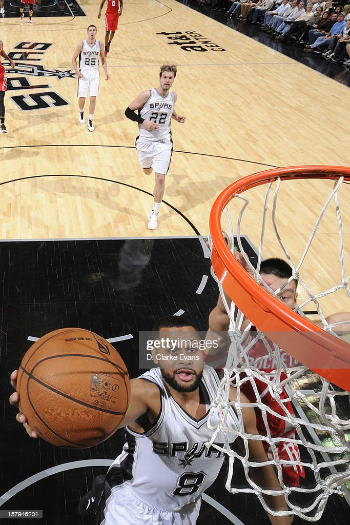 <a gi-track='captionPersonalityLinkClicked' href=/galleries/search?phrase=Patrick+Mills&family=editorial&specificpeople=550011 ng-click='$event.stopPropagation()'>Patrick Mills</a> #8 of the San Antonio Spurs drives to the basket against the Houston Rockets on December 7, 2012 at the AT&T Center in San Antonio, Texas.