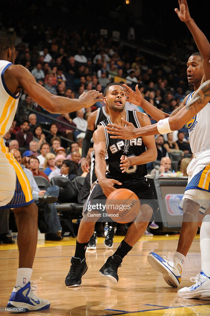<a gi-track='captionPersonalityLinkClicked' href=/galleries/search?phrase=Patrick+Mills&family=editorial&specificpeople=550011 ng-click='$event.stopPropagation()'>Patrick Mills</a> #8 of the San Antonio Spurs passes in the lane against the Golden State Warriors on April 26, 2012 at Oracle Arena in Oakland, California.
