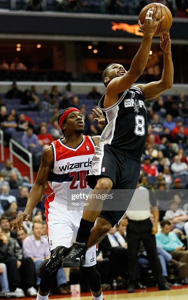 <a gi-track='captionPersonalityLinkClicked' href=/galleries/search?phrase=Patrick+Mills&family=editorial&specificpeople=550011 ng-click='$event.stopPropagation()'>Patrick Mills</a> #8 of the San Antonio Spurs puts up a shot in front of <a gi-track='captionPersonalityLinkClicked' href=/galleries/search?phrase=Cartier+Martin&family=editorial&specificpeople=834581 ng-click='$event.stopPropagation()'>Cartier Martin</a> #20 of the Washington Wizards during the second half at Verizon Center on November 26, 2012 in Washington, DC.