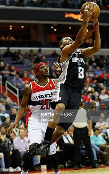 Patrick Mills of the San Antonio Spurs puts up a shot in front of Cartier Martin of the Washington Wizards during the second half at Verizon Center...