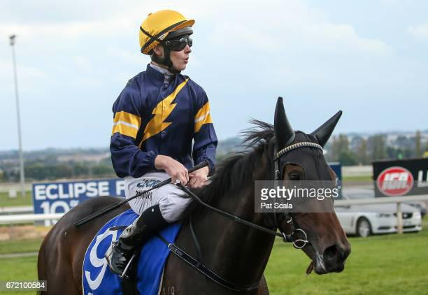 Patrick Moloney returns to the mounting yard on Lilymorn after winning OTI Maiden Plate at SportsbetBallarat Racecourse on April 24 2017 in Ballarat...
