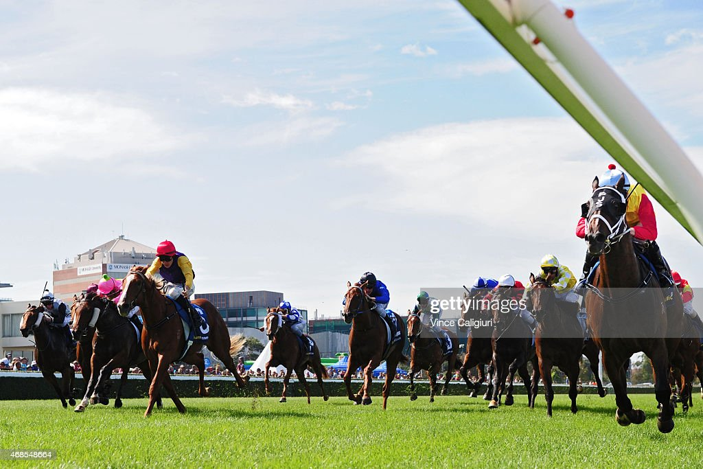 Patrick Moloney riding Caro Kann (r) wins Race 1, during Melbourne racing at Caulfield Racecourse on April 4, 2015 in Melbourne, Australia.