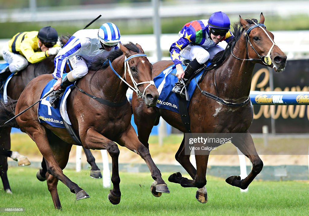 Patrick Moloney riding Magicool (r) defeats Luke Nolen riding Triple Gold in Race 3 during Melbourne racing at Caulfield Racecourse on April 4, 2015 in Melbourne, Australia.