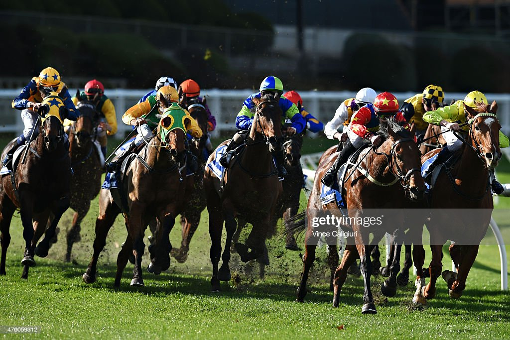 Patrick Moloney riding Prince Rahy (r) turns into the home straight before defeating Damien Thornton riding Rock 'n' Gold in Race 4 during Melbourne Racing at Moonee Valley Racecourse on June 6, 2015 in Melbourne, Australia.