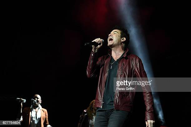 Patrick Monahan of the band Train performs in concert at Star 941 Jingle Jam at Infinite Energy Arena on December 4 2016 in Duluth Georgia