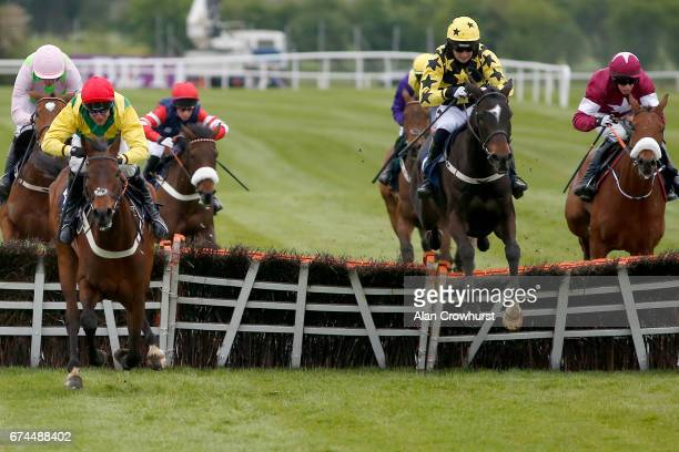 Patrick Mullins riding Bacardys clear the last to win The Tattersalls Ireland Champion Novice Hurdle Race from Finianas Oscar at Punchestown...
